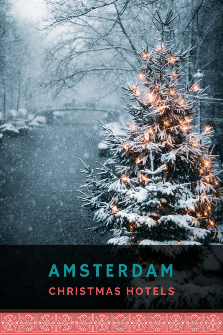 Amsterdam canal during the snow with a Christmas tree and lights