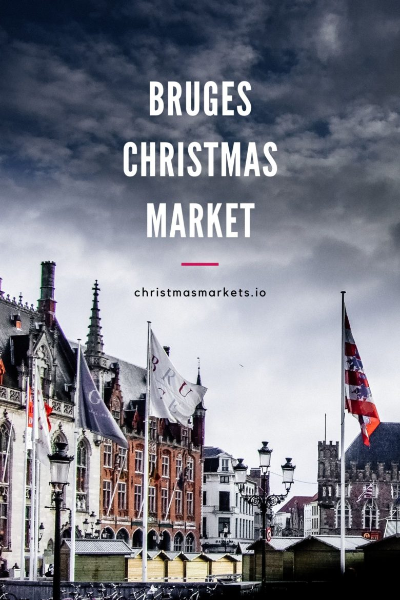 Market Square in Bruges with flags flying.