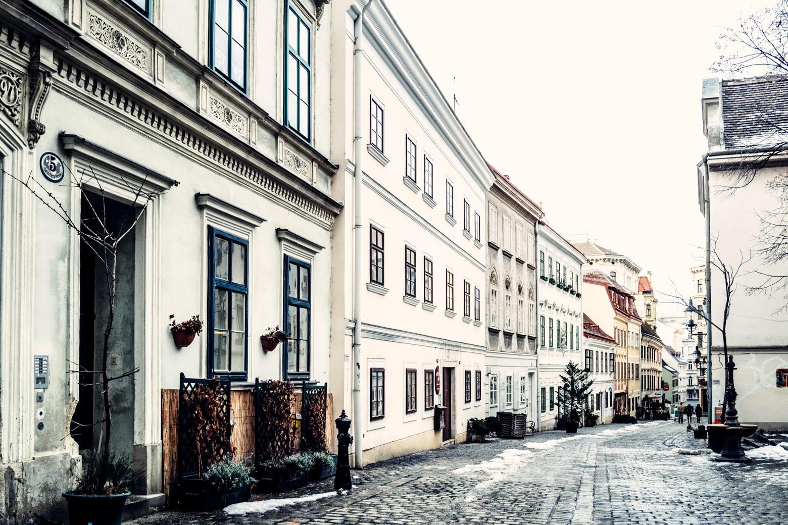 Cobblestone street in Vienna with snow.